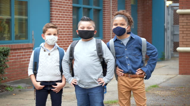 boys outside elementary school wearing face masks - 8 9 years stock videos & royalty-free footage
