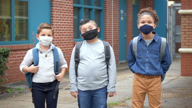 boys outside elementary school wearing face masks - 10 11 years stock videos & royalty-free footage