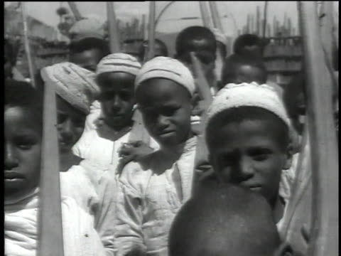 boys performing drill and marching in formation with fake wooden rifles / ethiopia - 1935 stock videos & royalty-free footage