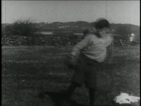 boys play baseball in a field / united states - 1913 stock-videos und b-roll-filmmaterial