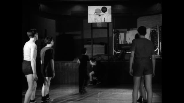 boys play basketball together in a youth club; 1960 - youth club stock videos & royalty-free footage