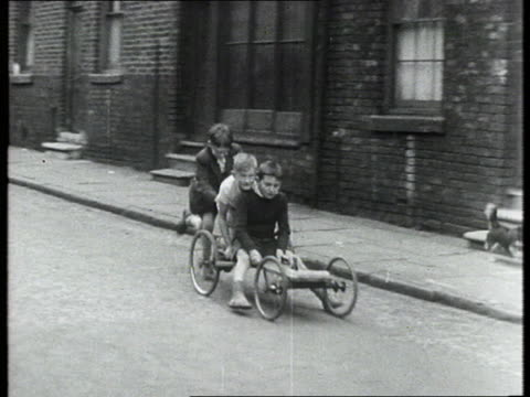 boys play on gokart in street - 1950 1959 stock videos & royalty-free footage