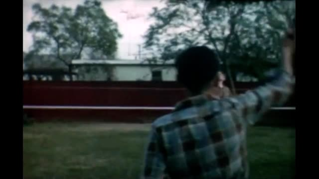 1965 boys playing badminton - short sleeved stock videos & royalty-free footage