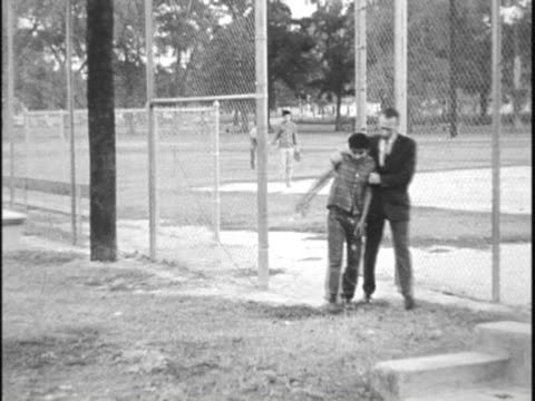 stockvideo's en b-roll-footage met boys playing baseball, start fighting, man breaks up fight / boy meets with probation officer - 1962