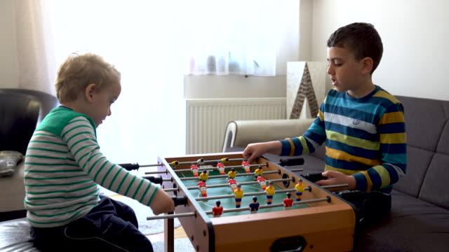 boys playing foosball - sporting term stock videos & royalty-free footage