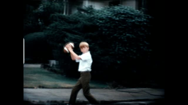 boys playing football 1960's - retro style stock videos & royalty-free footage
