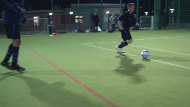 ws ts pov shaky boys (14-15) playing football, london, uk - shaky stock videos & royalty-free footage