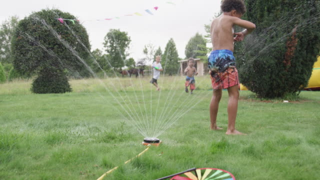 boys playing in garden - semi dress stock videos & royalty-free footage