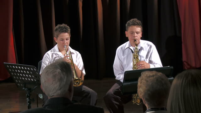 hd: boys playing instruments - saxophone stock videos and b-roll footage