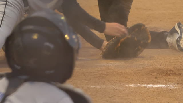 stockvideo's en b-roll-footage met boys playing little league baseball game, batter hits home run. - slow motion - honkbal teamsport
