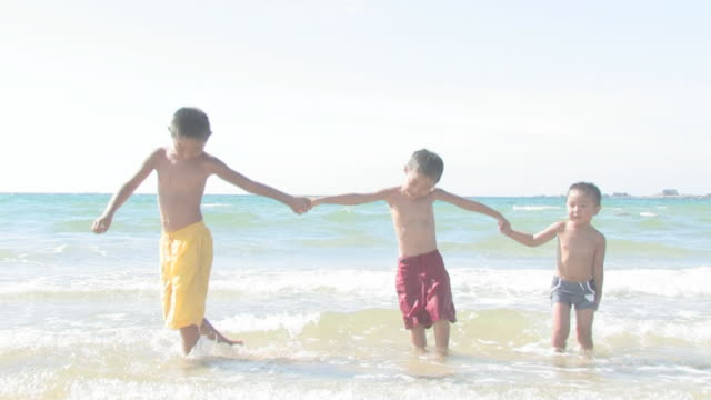 Boys playing on shore