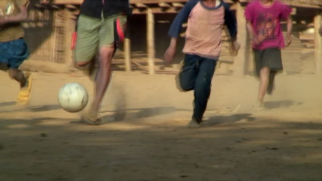 WS ZO Boys playing soccer in village, Pak Ou Villages, Laos