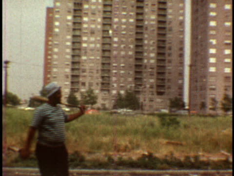 1973 MONTAGE Boys playing softball in street / Bronx, New York