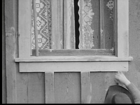 1913 b/w ms boys quietly sneaking up to window and climbing in / usa - 1913 stock-videos und b-roll-filmmaterial