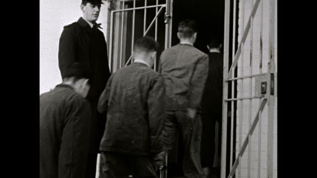 boys return to borstal dormitory through prison door; 1958 - obedience stock videos & royalty-free footage