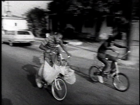 boys riding bikes - 1968 stock-videos und b-roll-filmmaterial