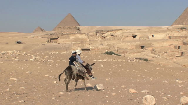 WS ZO Boys riding donkey toward Pyramid of Cheops, Cairo, Egypt