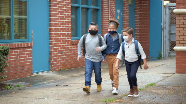 boys running outside elementary school with face masks - 8 9 years stock videos & royalty-free footage