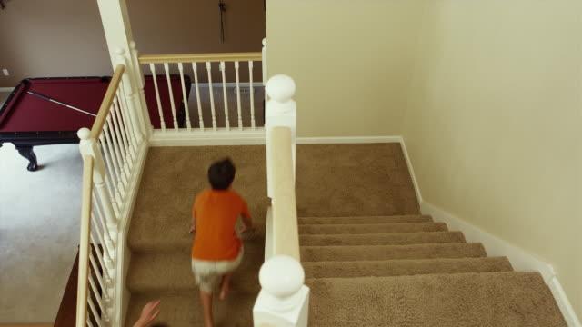 WS Boys (12-17) running upstairs / Renton, Washington, USA