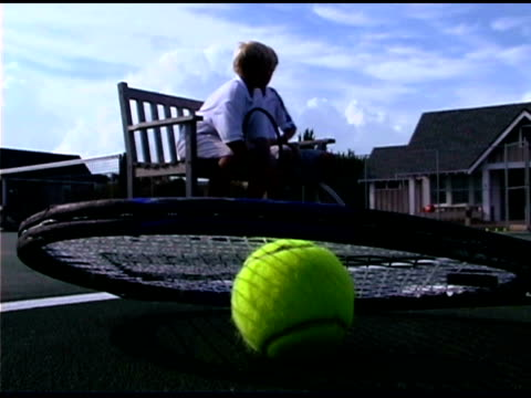 boys sitting on bench by tennis racket - tennis racket stock videos & royalty-free footage