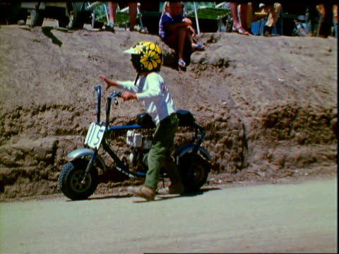 boys sitting on honda minibike motorcycles at starting line of mercury minibike clutch held in semiarid deserts of california white man waving green... - start flag stock videos & royalty-free footage