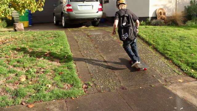 boys skateboarding up driveway - portland oregon stock videos & royalty-free footage