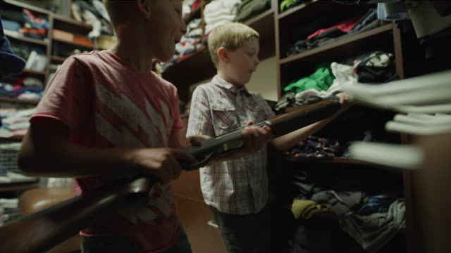 vídeos de stock e filmes b-roll de boys sneaking into closet and discovering rifle / cedar hills, utah, united states - travessura