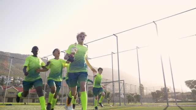 boys soccer team running with trophy - football team stock videos & royalty-free footage