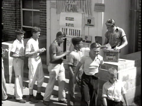 boys stand in a line to put their ballots in a box during an election - 1965 stock videos & royalty-free footage
