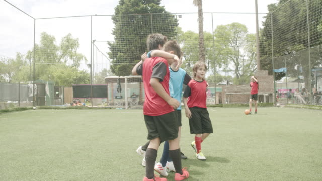 boys standing arm around on soccer field - organised group stock videos & royalty-free footage