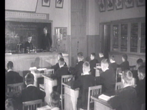 Boys studying physics and electricity and girls in the children's section of the Lenin Library in Moscow / Russia AUDIO