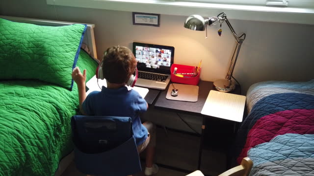 boys taking online classes in their homes. students receiving classes while attending online distance learning from home. in miami, florida, u.s., on... - using computer stock videos & royalty-free footage