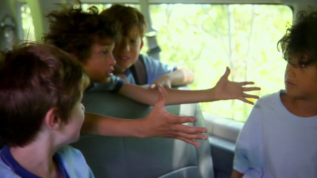 ms, r/f, pan, boys (8-11) talking and giggling sitting in van, bovina, new york state, usa - elementary age stock videos & royalty-free footage
