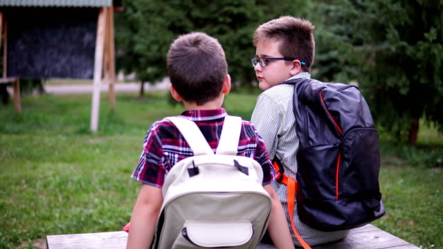 Boys talking in the park after school