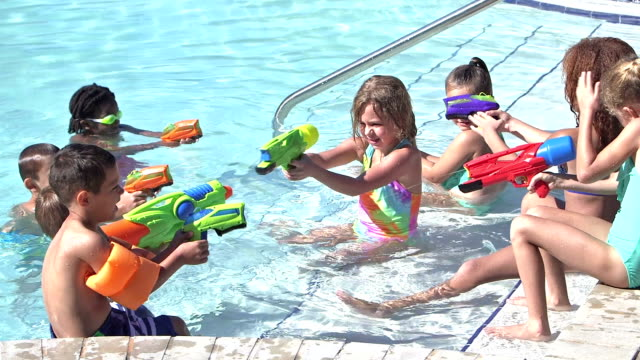 Boys versus girls in water gun battle