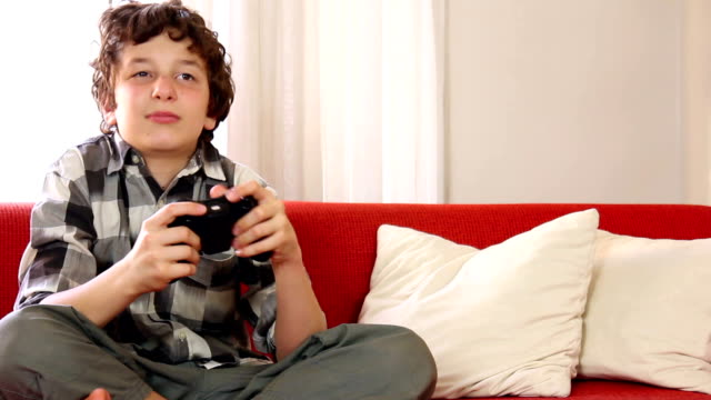boy's video game victory - game show stock videos & royalty-free footage