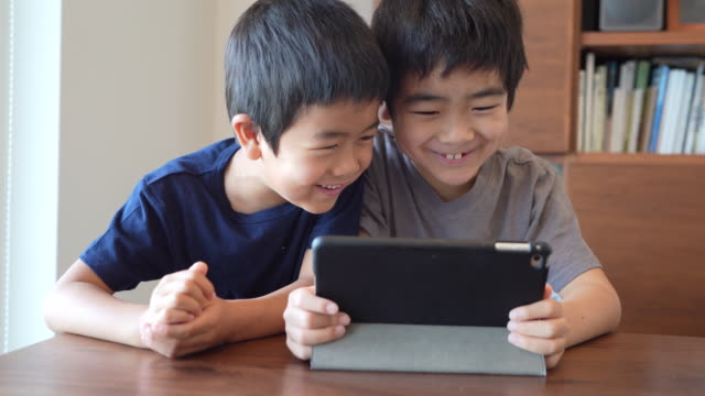 boys watching tablet - kids stock videos & royalty-free footage