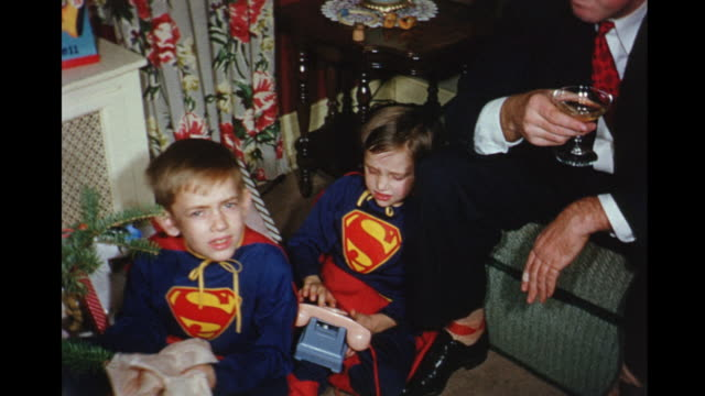 1956 home movie boys wearing superman costumes at christmas / toronto, canada - boys stock videos & royalty-free footage