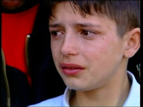 stockvideo's en b-roll-footage met boys whose deaths provoked unrest buried itn serbia kosovo cabra boys carrying photographs of the ethnic albanian boys whose deaths led to latest... - kosovo