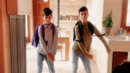 Boys with backpacks doing the viral floss dance at home