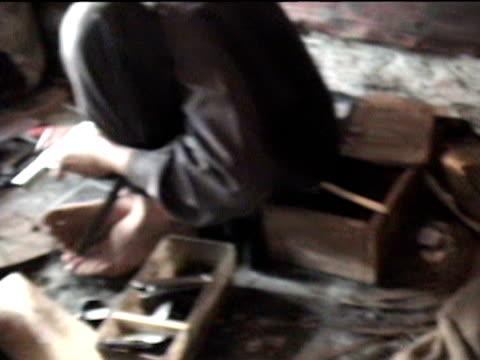 boys working in gun making factory, sakha kot in swat agency of tribal zones, federally administered tribal areas, pakistan, audio - 男児のみ点の映像素材/bロール