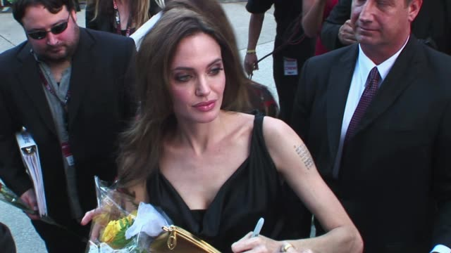 brad and angelia on the red carpet for the 2011 film premier of moneyball at the toronto film festival angelina jolie at 2012 tiff at 2011 toronto... - angelina jolie stock videos & royalty-free footage