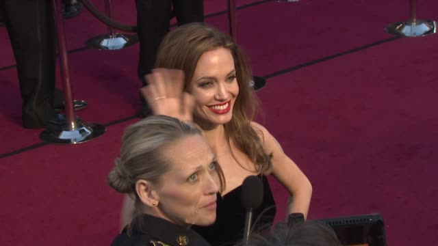 brad pitt and angelina jolie at 84th annual academy awards - arrivals on 2/26/12 in hollywood, ca. - angelina jolie stock-videos und b-roll-filmmaterial