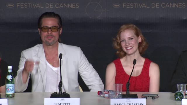 brad pitt, dede gardner on the use of dinosaurs being used at the the tree of life press conference: 64th cannes film festival at cannes . - interview raw footage stock videos & royalty-free footage