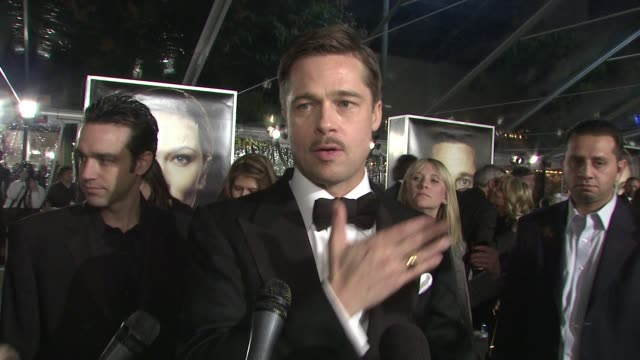 brad pitt on the experience of filming in new orleans, his housing project for displaced hurricane katrina residents at the 'the curious case of... - インタビュー素材点の映像素材/bロール