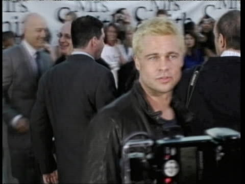 "brad pitt smiles and poses for photographers while on the red carpet at the premiere of ""mr. and mrs. smith."" - brad pitt actor stock videos & royalty-free footage"
