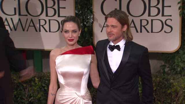 stockvideo's en b-roll-footage met bradd pitt and angelina jolie at 69th annual golden globe awards arrivals on january 15 2012 in beverly hills california - golden globe awards
