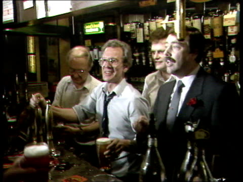 bradford 4730 labour supporters in pub supporters applauding labour winner candidate standing behind bar talking to people in pub about labour party... - scotland stock videos & royalty-free footage