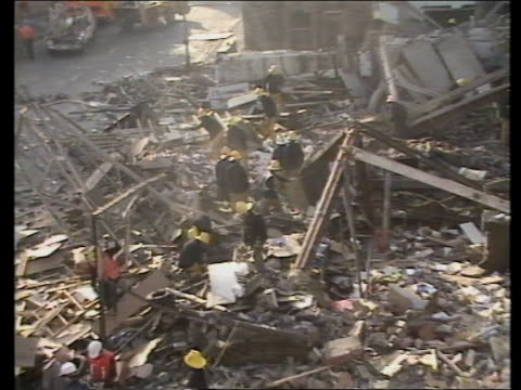 Bradford garage explosion Yorkshire Bradford Morley Street TS Ruins of garage as firemen in rubble TMS Firemen sifting through rubble PULL OUT MS...