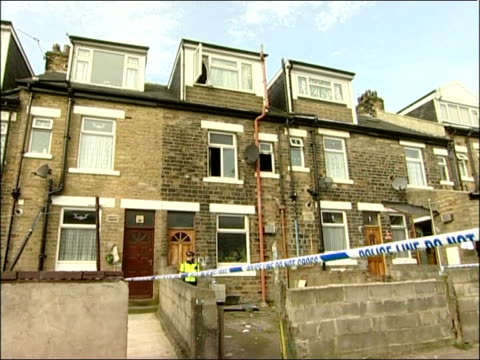 bradford house fire kills five week old baby girl england yorkshire bradford ext police and cordon tape outside house where fire occured - itv weekend evening news stock-videos und b-roll-filmmaterial